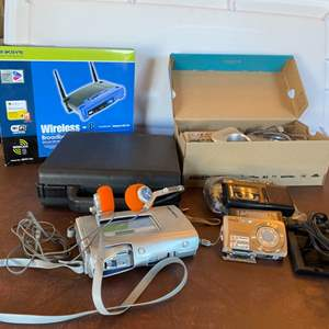 Lot # 158 - Linksys wireless broadband router(New in box) and other great electronics with cassettes