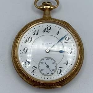 Lot # 29 - 14k gold Elgin 16 size, 17 jewel open face pocket watch.