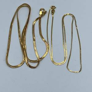 Lot # 34 - Two herringbone 14 karat necklaces (8.8g)
