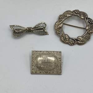 Lot # 19 - Three sterling pins (15.9 g)