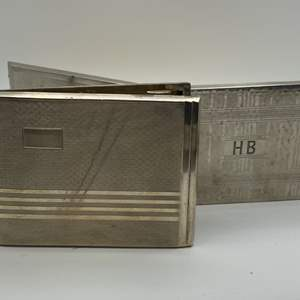 Lot # 35 - Two nickel silver cigarette cases  (225.7g total weight)