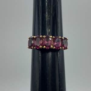 Lot # 39 - 10 karat gold ring with 5, 1/2 carat Garnett's