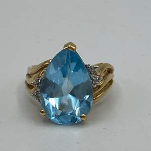 Lot # 53 - 10 karat gold ring with 5+ carat teardrop topaz and pave diamonds (4.4g total weight)