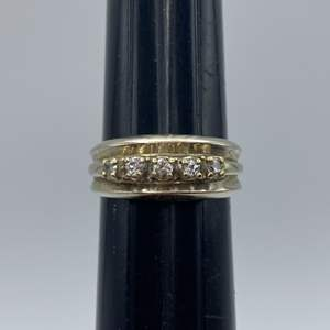 Lot # 61 - 14 karat gold ring with five .05c diamonds (7.4g total weight)