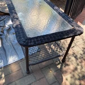 Lot # 298 - Outdoor wicker (plastic) table