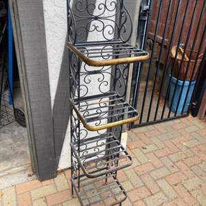 Lot # 303 - Iron and brass rack