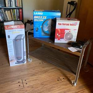 Lot # 9 - Mid century utility cart, fans, heaters and clock