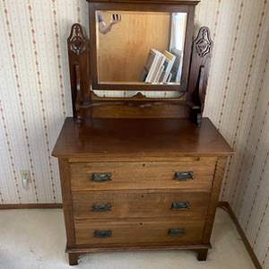 Lot # 125 - Beautiful antique dresser with beveled mirror and key