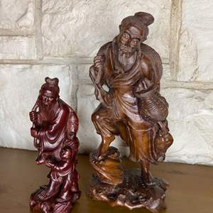 Lot # 198 - Two carved wooden Asian figurines