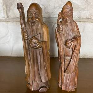 Lot # 200 - Two hand carved wooden Asian figurines