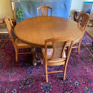Lot # 206 - Dining room table with four chairs plus 4 leafs