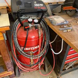 Lot # 4 - Craftsman 33 gallon upright air compressor with hoses and attachments