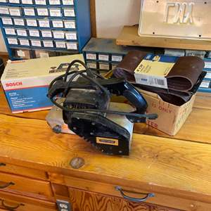 """Lot # 17 - Craftsman and Bosch 4"""" sanders with lots of sanding belts"""