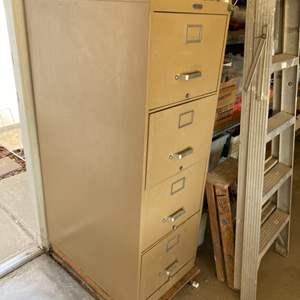 Lot # 46 - Four drawer metal locking file cabinet with key