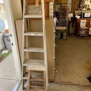 Lot # 47 - 6' aluminum folding step ladder and 2' wood folding step ladder