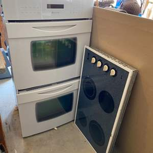 Lot # 48 - Jenn-Air electric double oven with Whirlpool four burner electric stove top