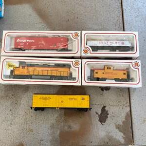 Lot # 60 - Union Pacific engine and caboose with three other train cars, HO scale