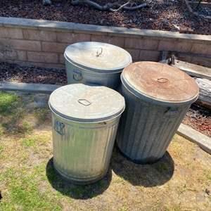 Lot # 76 - Three galvanized trash cans