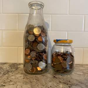 Lot # 81 - Two jars loaded with coins!