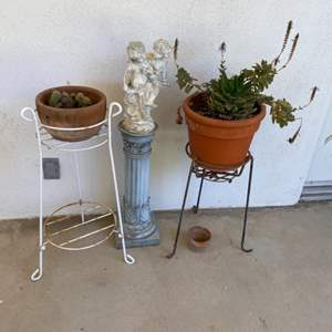 Lot # 82 - Plant stands, pot and yard decor