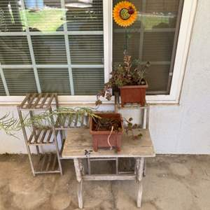 Lot # 83 - Plant stands and two pots