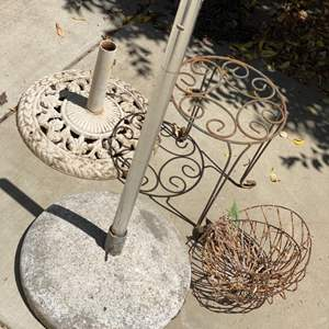Lot # 87 - Umbrella stands, metal patio table and metal baskets