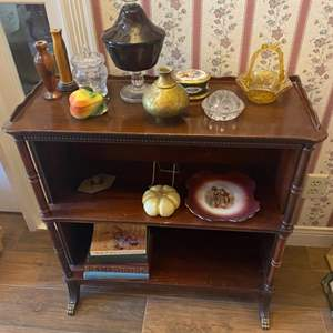 Lot # 275 - Antique mahogany bookshelf with brass feet contents included