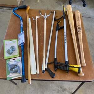 Lot # 300 - Canes, pick up tools, and bats