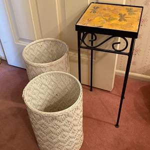 Lot # 348 - Tile top table and two trash canisters