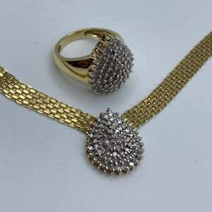 Lot # 1 - 10 karat gold and diamond necklace with matching ring (18.3g total weight)