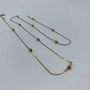 Lot # 11 - 14 karat gold chain (1.2g)