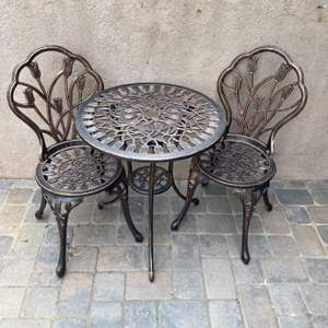 Lot # 47 - Metal bistro table with two chairs