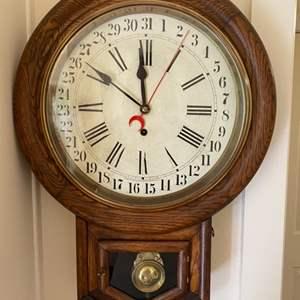 Lot # 107 - Waterbury calendar wall clock round head drop style in Oak case.