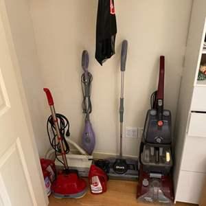 Lot # 158 - Utility closet items, vacuum, sweaters, etc.