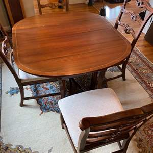 Lot # 223 - Beautiful dining room table with inlaid wood edge, six leaves, four chairs and felt table top pads