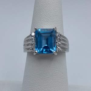 Lot # 8 - 14K White gold .26 CTW diamonds, blue topaz size 6.75