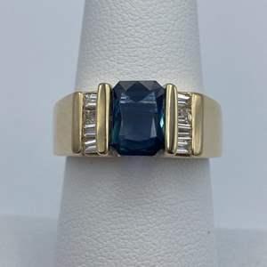 Lot # 14 - 14k Gold ring, 1/3ctw diamond, 1.29 sapphire, size 7.25