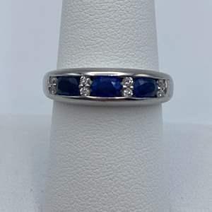 Lot # 19 - Platinum ring, .11ctw diamond, 1.02ctw sapphire, size 8.25