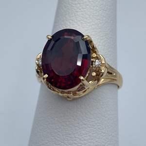 Lot # 25 - 18k gold garnet ring, size 6