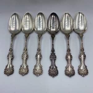 Lot # 42 - Sterling set of 1900's spoons (295g)