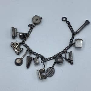 Lot # 47 -  Sterling charm bracelet (19.3g)