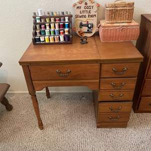 Lot # 51 - Sewing Machine cabinet/ Assorted Thread & storage baskets