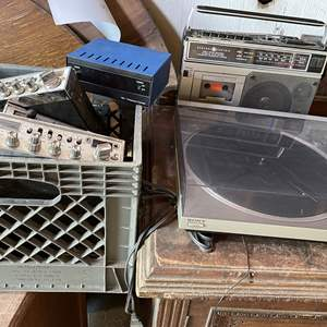 Lot # 100 - Sony Record Player, GE Radio and an assortment of CB Radios (Condition Unknown)