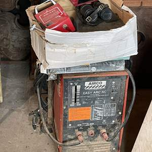 Lot # 210- Airco Easy Arc Stick Welder And Box Of Odds and Ends