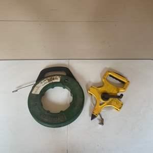Lot # 73 - Open Reel Measuring Tape and Metal Fish Tape