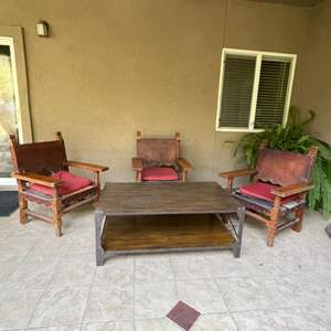 Lot # 81 -  Mexican Spanish Style Venadillo Wood & Leather Armchairs/ Wood Top Coffee Table w/metal legs (Matches Lot# 82)