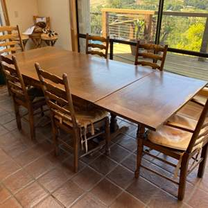 Lot # 52 - Farmhouse table and 6 chairs with leather cushions