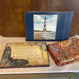 Lot # 98 - Table linens, runner, placemats, artwork