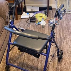 Lot # 157 - Folding walker with seat