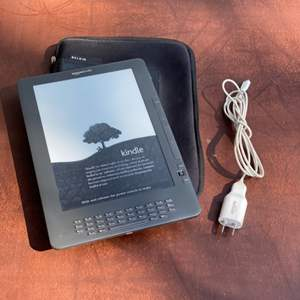 Lot # 179 - Kindle with case and cord